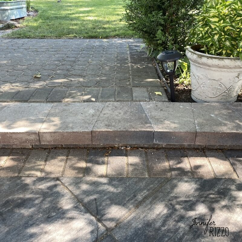Adding a stone step to a new patio