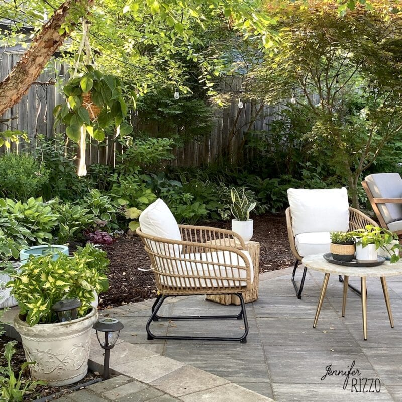 Rattan lounger chair with white cushions for outside