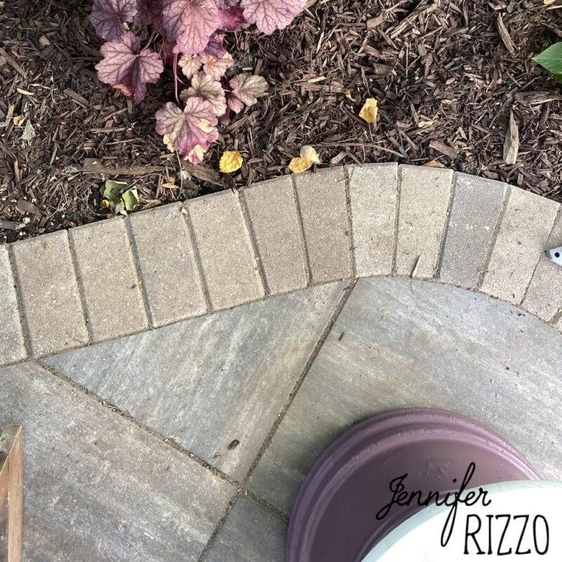 Stone patio edging with bricks