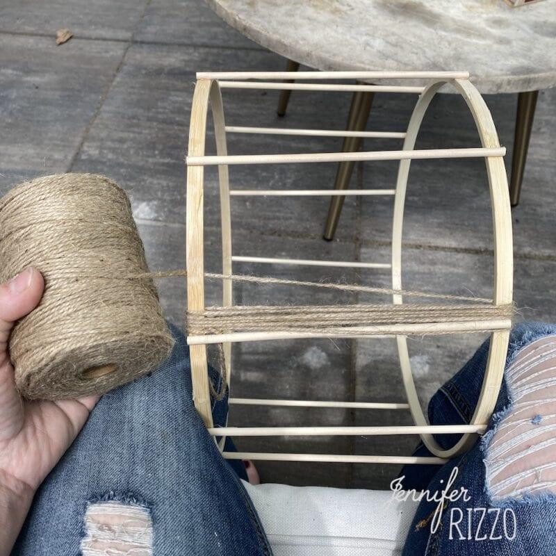 Wrap twine around hoops to make a lantern