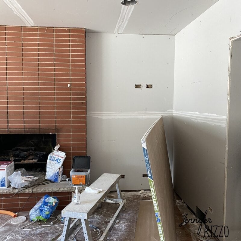 Fireplace and drywall before adding built ins