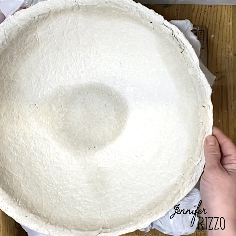 Flip bowl over to let the inside dry supporting the outer edges