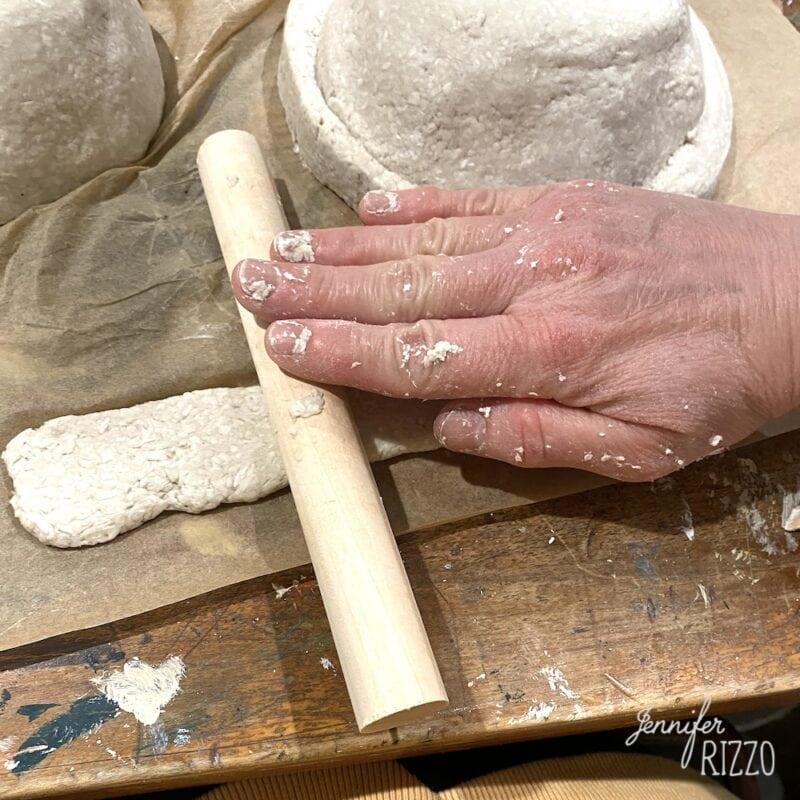 Roll put paper mache with a dowel rod
