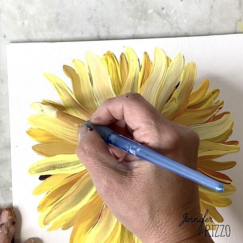 Add bright yellow to create a suflower petals