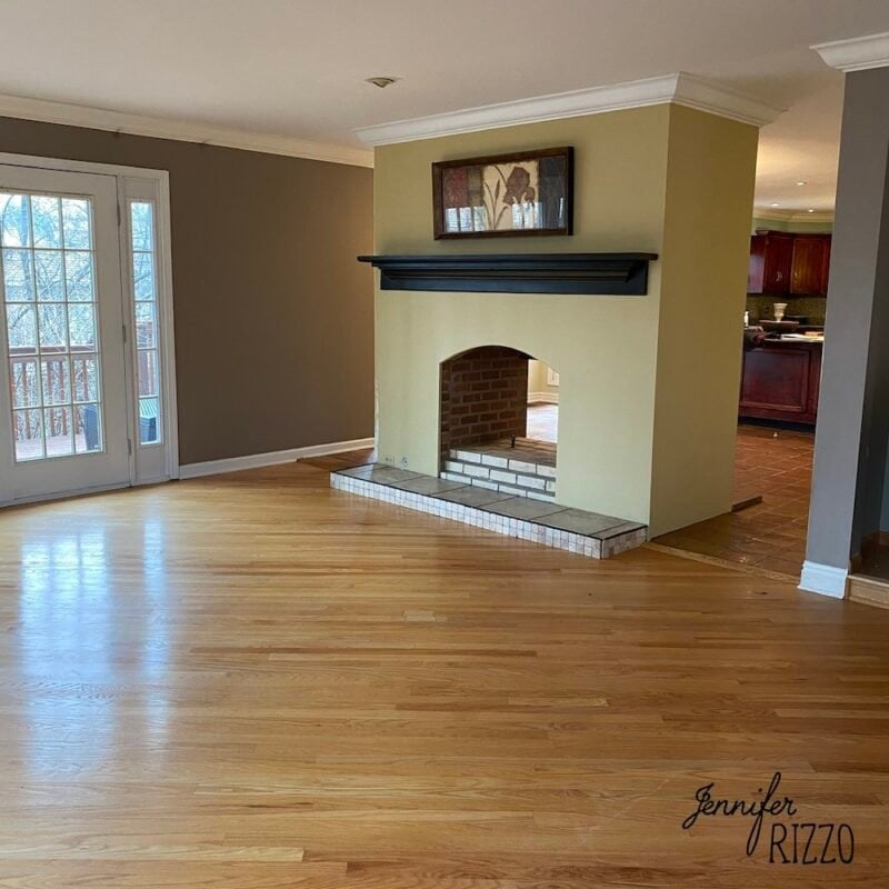Fireplace mantel and dry wall with wood floors
