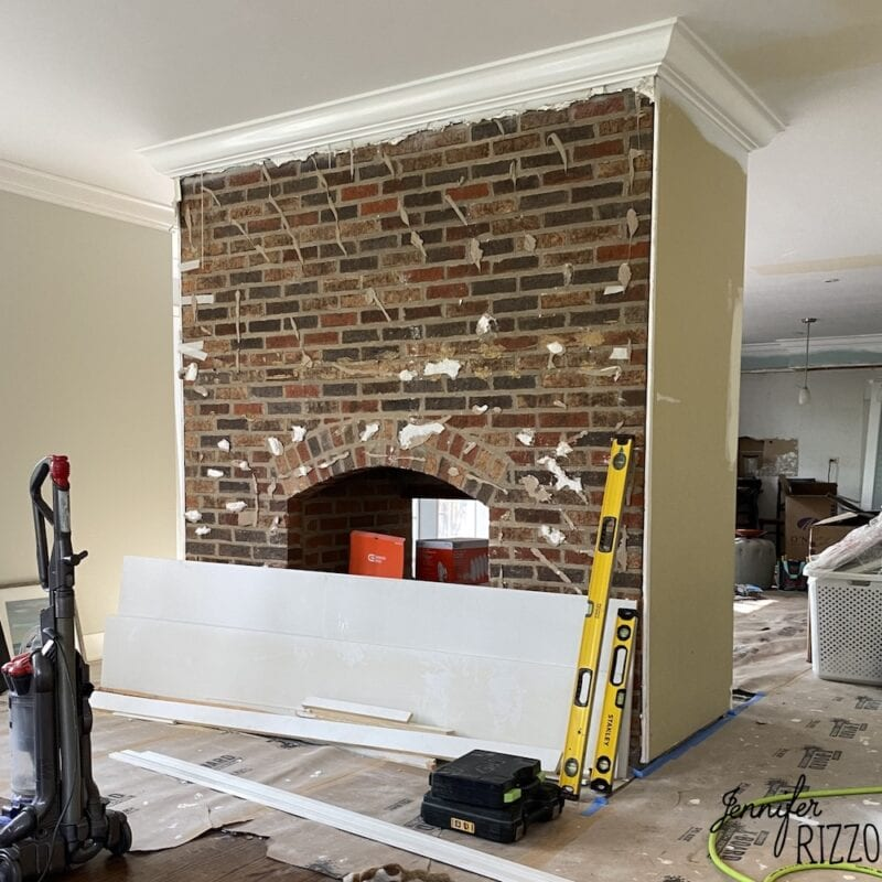 Fireplace removing old dry wall and painting brick