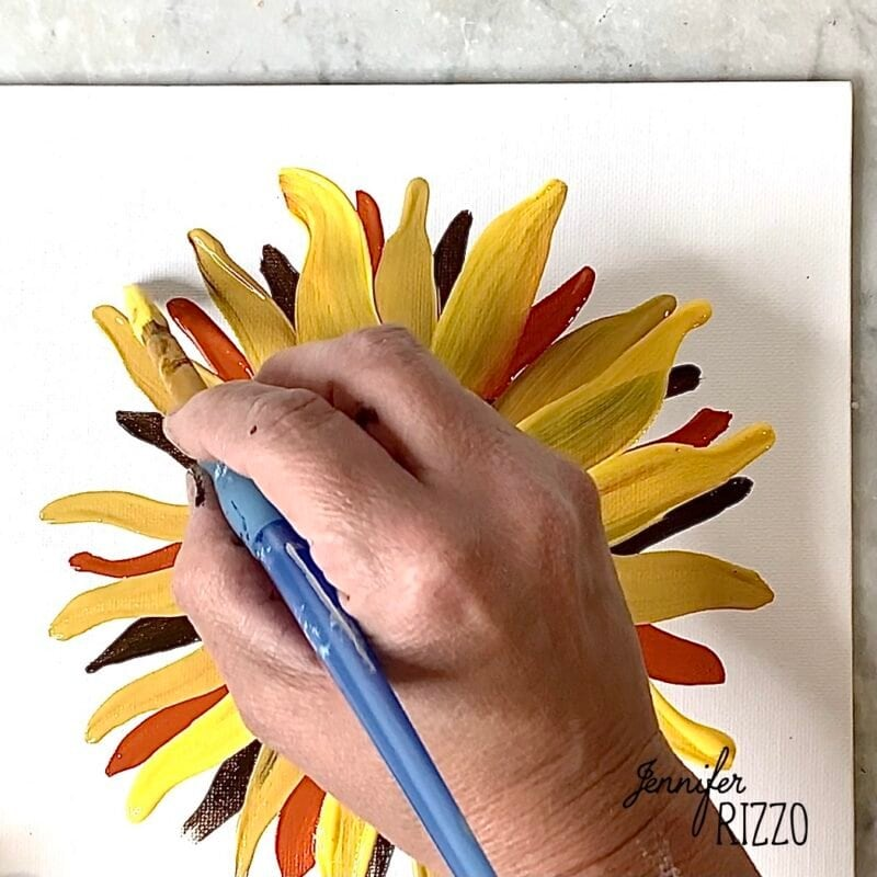 Paint the next layer of sunflower petals a with bright yellow