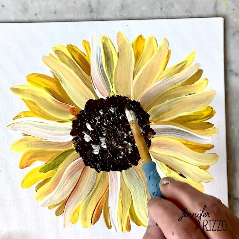 Stipple white paint in the center of the sunflower