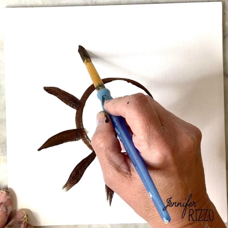 Use a round brush to create dark flower petals