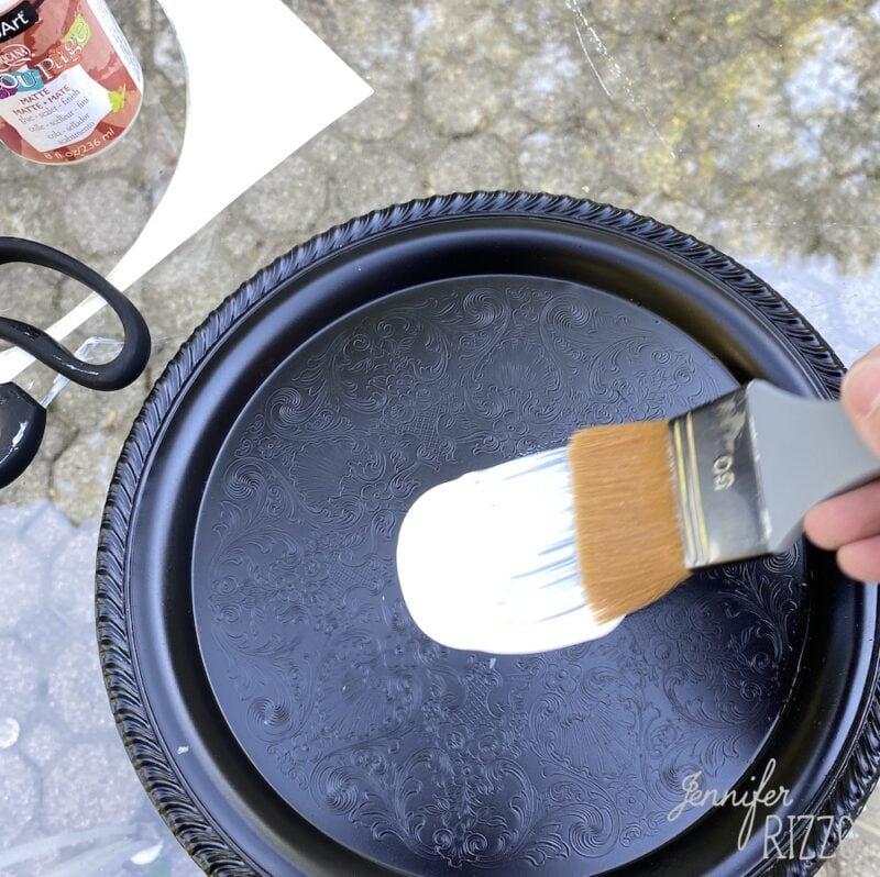 Add decoupage medium to tray top