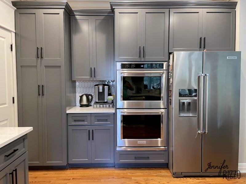 Cabinets after refacing with new tile backsplash