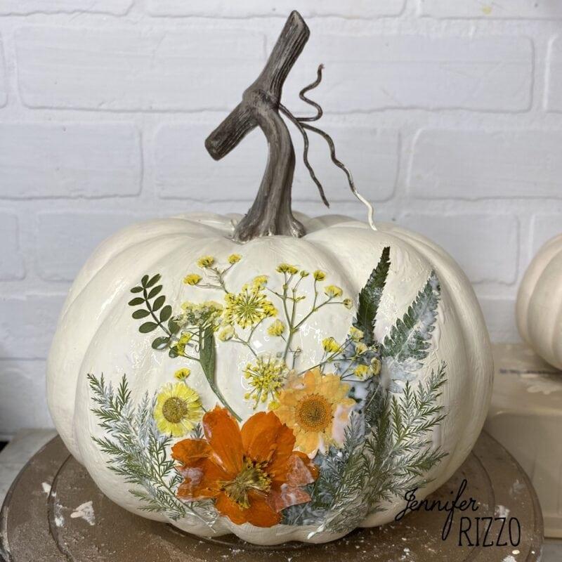 Dried flowers decoupaged on faux pumpkin