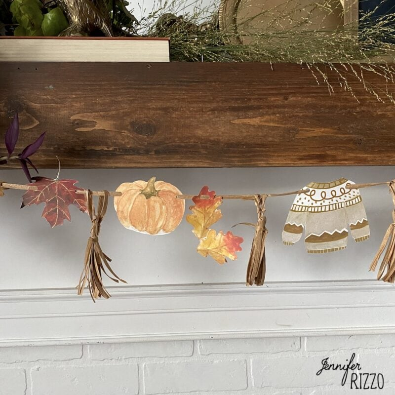 Fall banner with sweaters and pumpkins and raffia tassels