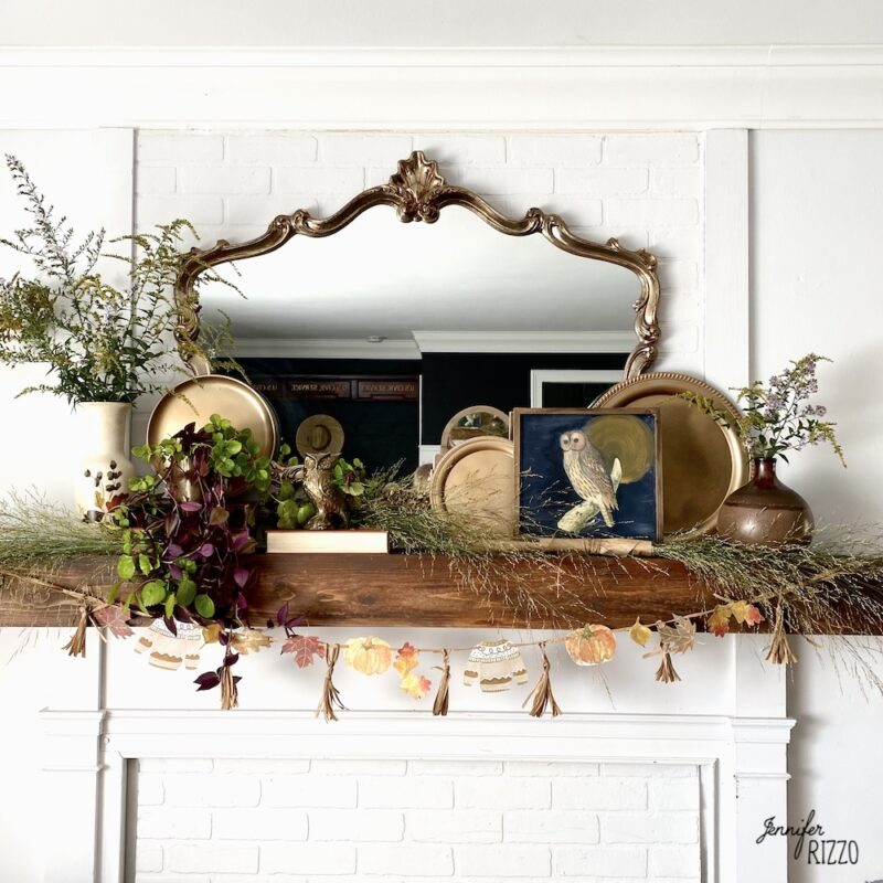 Fireplace mantel for fall with owls and wildflowers
