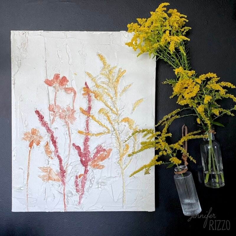 Pressed flower abstract art in spackling compound
