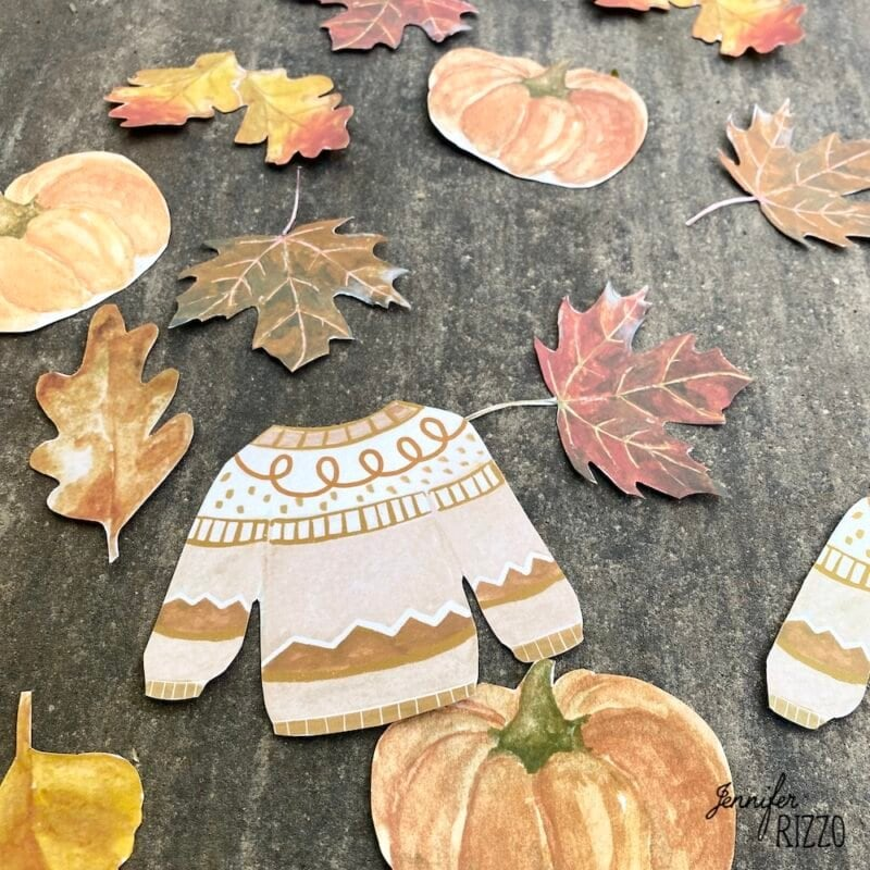 Sweater and pumpkin printables for a sweater and pumpkin fall banner with DIY raffia tassels